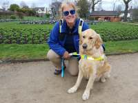 Tracey and Guide Dog Teddy shortly after qualifying, photographed in Caldicott Park, Rugby.